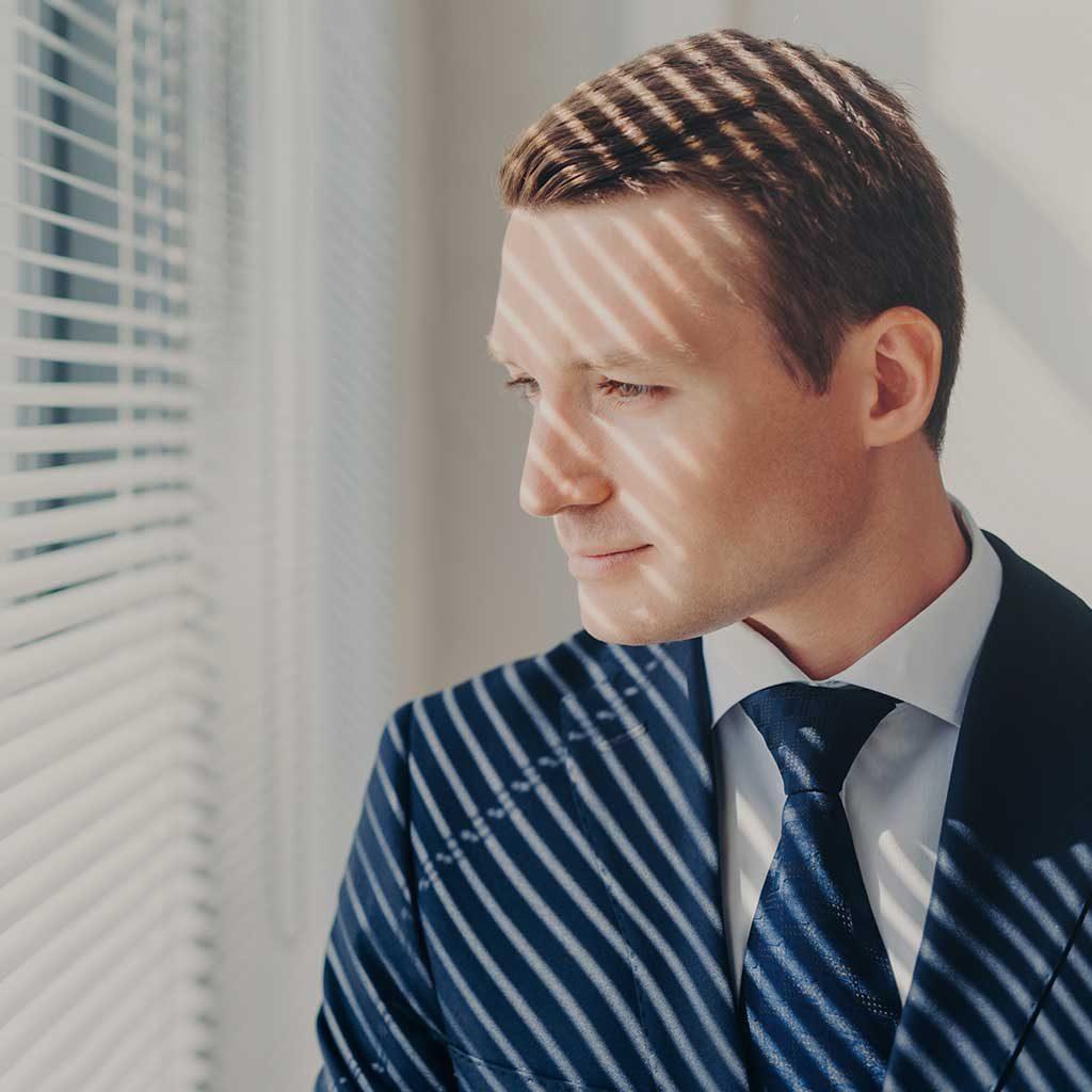 pensive-male-economist-dressed-in-formal-outfit-lo-V87PJUZ